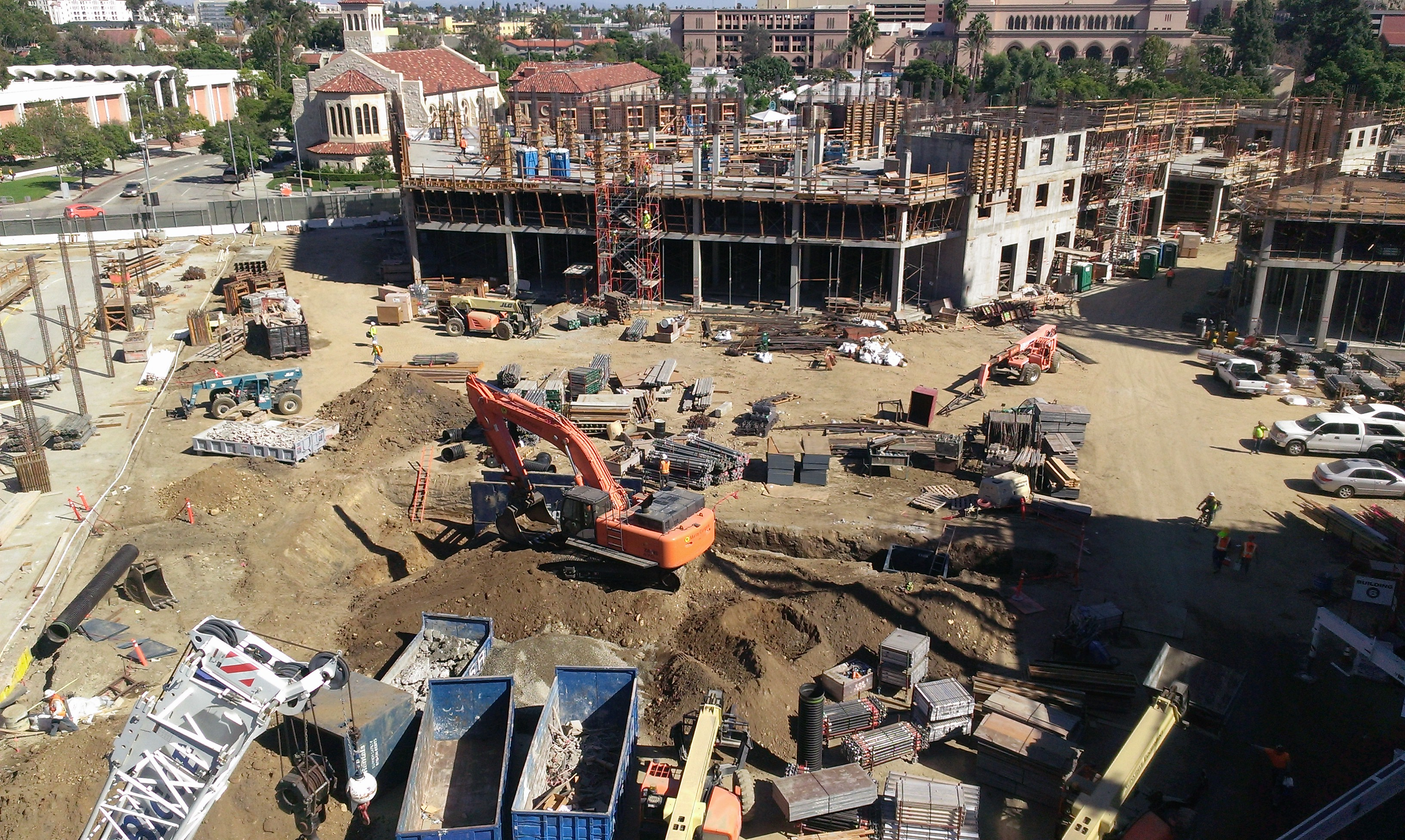 Utility work continues in the central plaza.